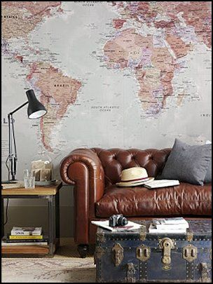 travel themed room. As a military family, we love travel-related and nautical themes for our living room. this here is a beautiful room!