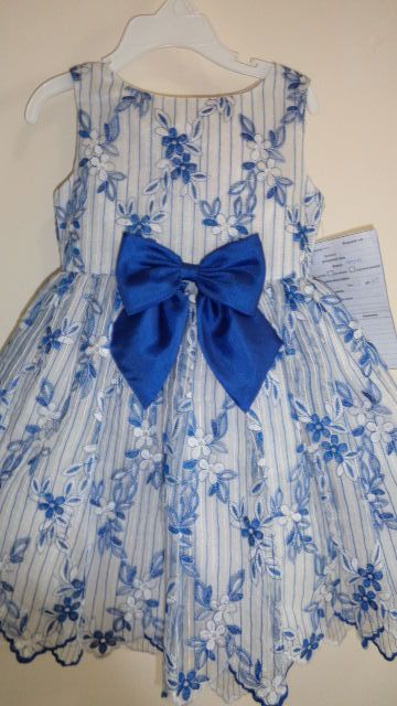girls embroidered dress with scalloped hem and big bow to match...precious!