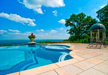Various patterns, murals, and mosaics are formed on the pool's floor and walls using glass tiles. Cipriano Custom Swimming Pools & Landscaping; Photography by Ed Pirone http://www.luxurypools.com/builders-designers/cipriano-landscape-design.aspx