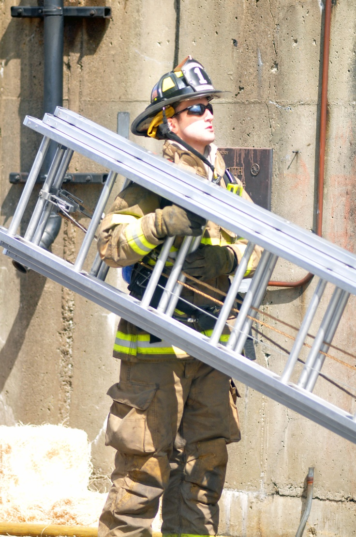 IFA Company One Firefighter Sam Phoebus checking overheard prior to throwing the ladder.