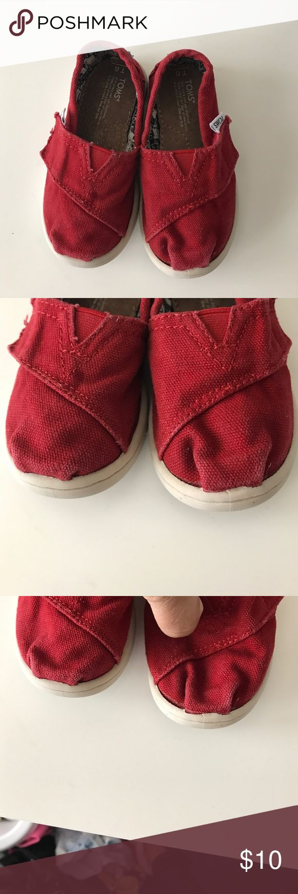 Toddler red Toms Red Toms size T6. The shoes definitely show signs of wear but still have life in them. If you pull on the front of the shoe if seems like the glue from shoe to sole might be be giving out due to being washed but it's nothing major (please refer to pics). TOMS Shoes Baby & Walker