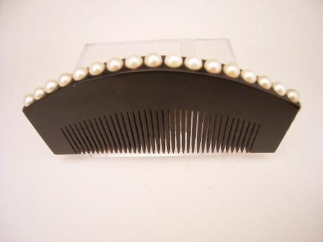 """JAPANESE EARLY 2OTH CENTURY COMB WITH PEARL DESIGN - Oriental Treasure Box Japanese early 20th century comb with pearl design. A wonderful dark comb with pearls inlaid into the side and top edges. The comb measures 4 3/8"""" wide, 2 1/16"""" tall and 3/8"""" thick. Unsigned."""