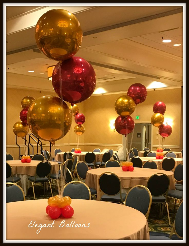 Gold red orbz balloons table centre pieces ideas