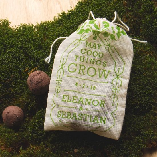 Bags of wildflower seeds printed with wedding info as favors