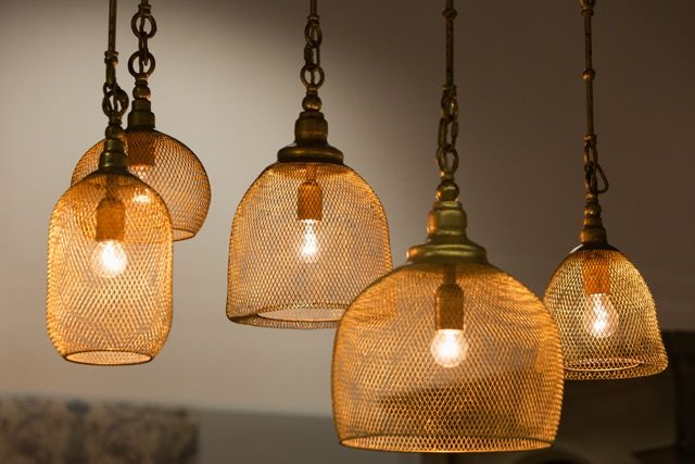 Kimi Lamps. Made of metal mesh, covered golden patina. The light is soft and warm.    Price 4 800 PLN