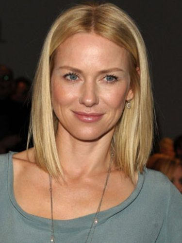 Naomi Watts' dark blonde shade complements her peachy make-up and skin tone.
