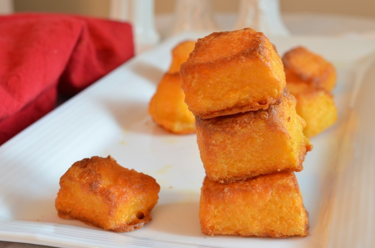 Cheese Bites...my mammaw used to make them but with Pepperidge Farm thin sliced bread....they are so good that then can easily be the death of you (from eating so many!)