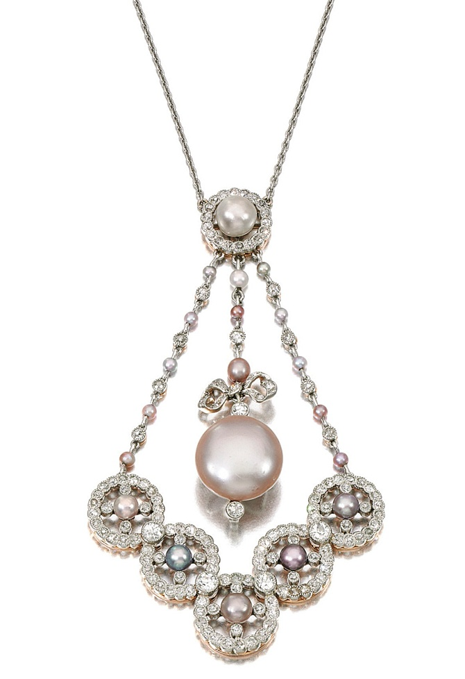 NATURAL PEARL AND DIAMOND PENDANT NECKLACE, EARLY 20TH CENTURY.  Set with variously coloured natural pearls, millegrain set with circular- and single-cut diamonds, length approximately 420mm.