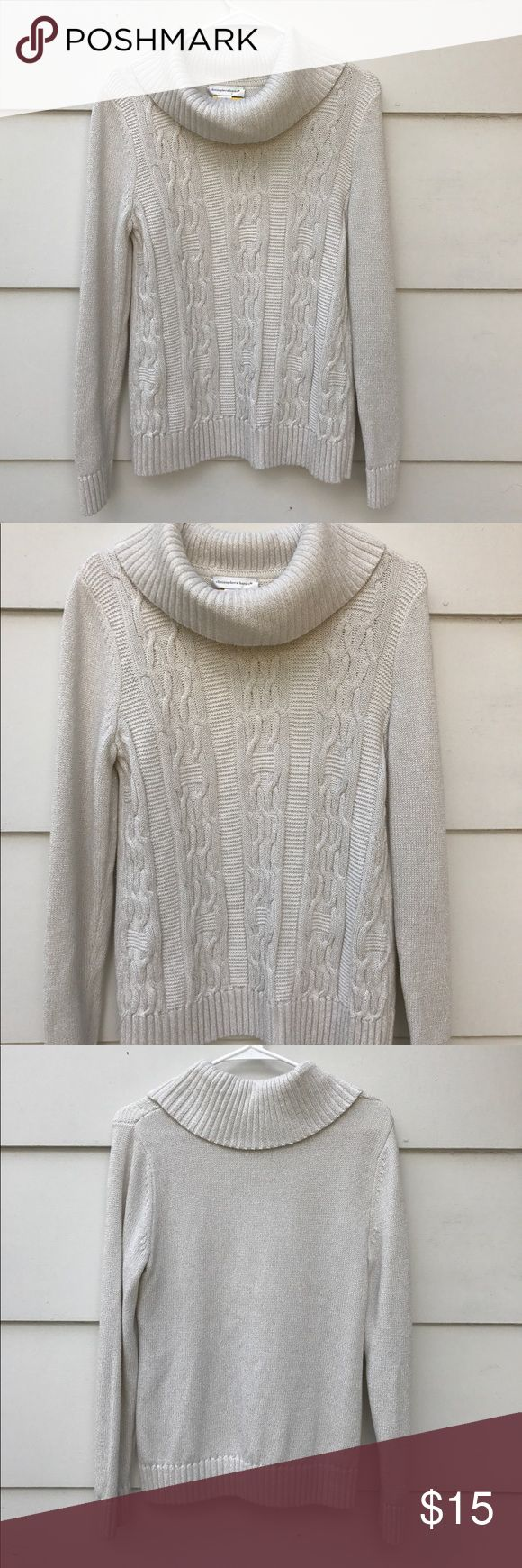 """Christopher & Banks White Cable Knit Sweater Lovely Christopher & Banks women's white cable knit pull over turtleneck sweater silver glitters shimmery. pre-owned, in very good condition. Size Small. Materials. 94% cotton 6% other fibers. Measurements. sleeves 24"""" shoulder 16"""" armpit 34"""" overall length 24"""" Christopher & Banks Sweaters Cowl & Turtlenecks"""