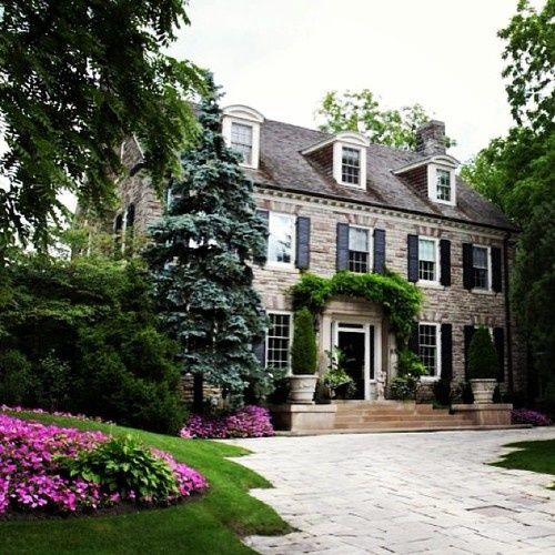 home exteriors - cottage home, black shutters, entry steps,  Gorgeous cottage home features stone beige stone exterior accented with black shutters. A classic mix of nostalgia and charm.