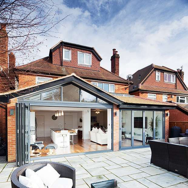 this is close to the look I had in mind for a end of house extension with the kitchen to the left and the lounge/living to the right opening out into a patio area for more accessibility for DS