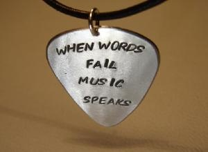 Guitar pick pendant when words fail music speaks on Handmade Artists\' Shop