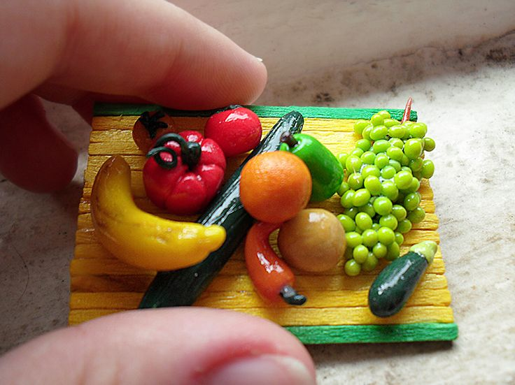 Fruity tooty! Fruit and vegetable preparation board, 1:12 scale polymer clay miniature. Handmade by me, including the tray at The Fairy Factoree: https://www.facebook.com/fairyfact?pnref=lhc