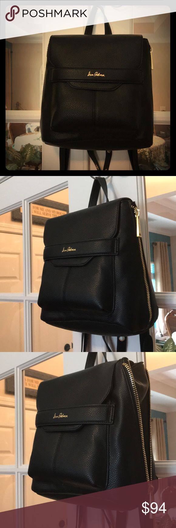 """🆕 Sam Edelman Black Pebbled Leather Backpack JUST IN‼️- This black Sam Edelman backpack is made of soft, pebbled leather.  Under the flap, the main compartment has a zippered pocket and large slip pocket.  There is also a front slip pocket under the flap and a wide zippered pocket on the rear of the bag.   Both sides of the bag can unzip to allow for expansion if needed!    Roughly 9.5""""L x 9.5""""W x 5.5""""H.   💞 Sam Edelman Bags Backpacks"""