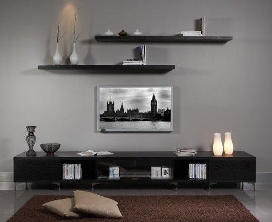 I think this is the look i'm going for in my living room - although I have three shelves over the TV - Just need to find an averaged priced cabinet-thing like this for underneath!