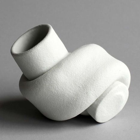 The shape of theses vases was derived from knotted rubber tubing.