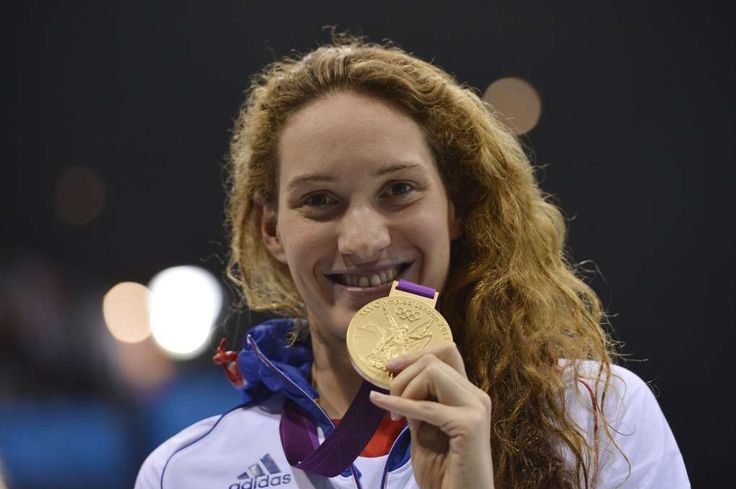 France's gold medalist Camille Muffat celebrates on the podium after winning the women's 400m freestyle swimming event at the London 2012 Olympic Games on July 29, 2012   RIP