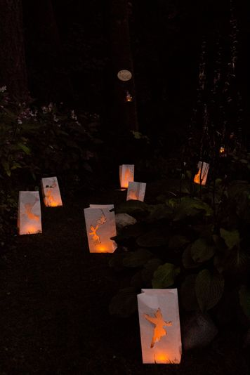 Peter Pan themed paper bag lanterns lining the forest path to the fairy section of our Peter Pan themed backyard wedding stylized photoshoot