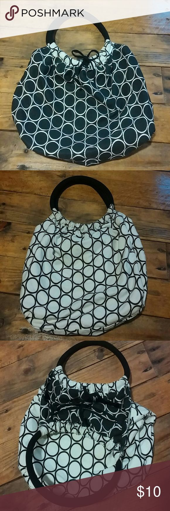 BLACK AND WHITE REVERSIBLE POLKA DOT PURSE So cute! Canvas hobo purse with polka dots, bag is reversible - black with white on one side and white with black on the other side. Handles are soft and rounded.   Measures 13 x 10 Bags