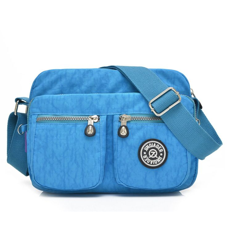 Tiny Chou Lightweight Waterproof Nylon Shoulder Bag Compact Crossbody Messenger Bag with Pockets Sky Blue. Material: High quality,lightweight waterproof nylon,the gorilla pendant is included.(with Tiny chou logo Cellphone Screen Clean Cloth). Dimension: 9.8 inch(L)*3.9 inch(W)* 7.8 inch(H);with adjustable shoulder strap. Multiple pockets design,one main zipper compartment can hold books,ipad,wallet,purse,umbrella,credit cards,cosmetics and so on;One back pocket and three front…