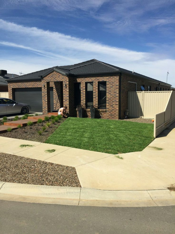 Macedon brick,  black windows, roof, gutter and fascia