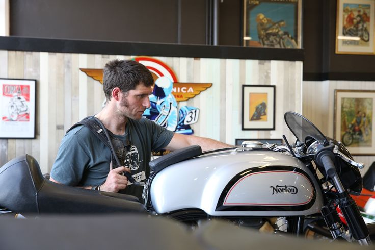 Guy Martin admiring the motorcycles at Classic Motorcycle Mecca. This bike in particular is a Norton.