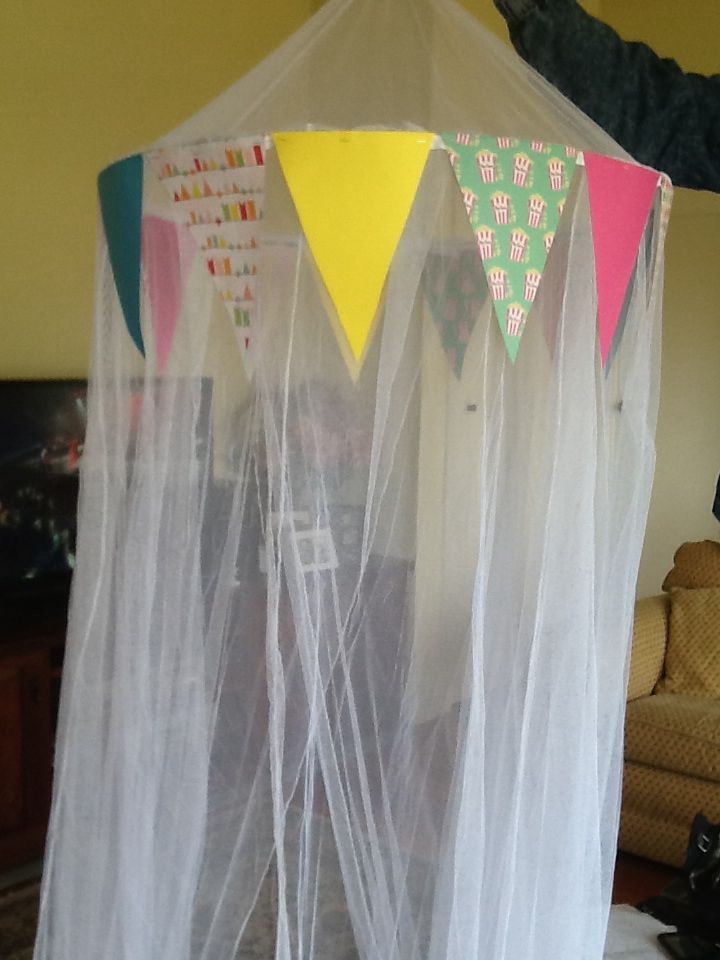 Paper bunting attached to mosquito net to make circus tent.