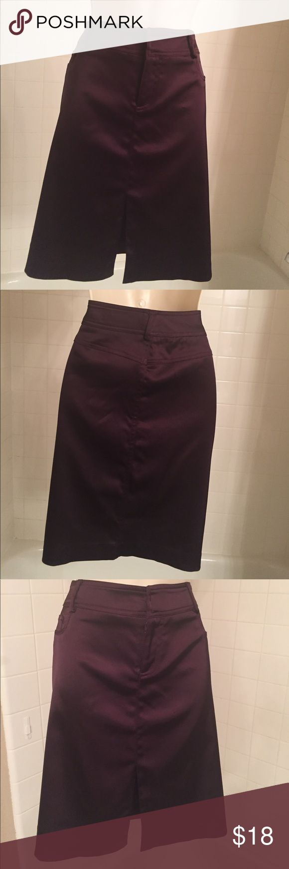 CACHE SKIRT SIZE 6 CACHE SKIRT WITH FRONT SLIT IN Front and belt loops. Pockets on both front sides do not open,   63% Acetate, 35% Naylon 2% Spandex. Color a Dark Purple..Size 6  Waist band side to side 16 1/2 inches. Length 20 1/2 inches . Great Final Price $18.00  Bundle and save 15%, one shipping. .. Please contact me if you need more Info. Cache Skirts