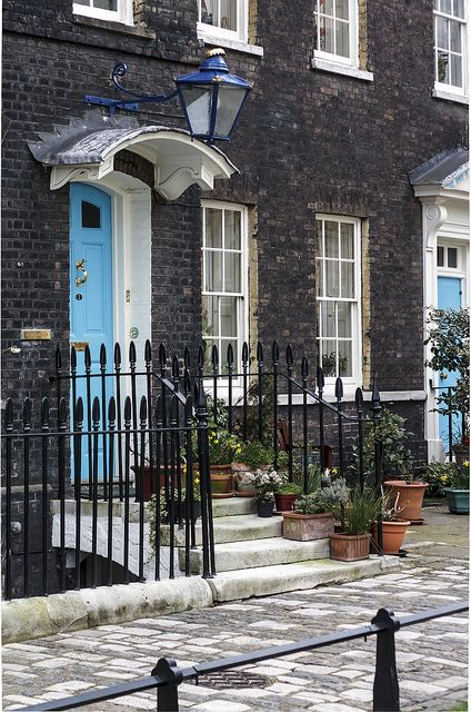 "Terraced House, London (a terraced house is what American would call a ""row house"" - they are extremely common in London with ""detached"" and ""semi-detached"" houses selling at a  considerable premium)"