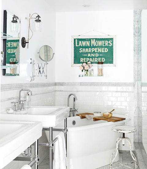 In the master bathroom of this Caifornia ranch, an old hand-painted metal sign pops above a salvaged cast-iron tub. The lab-inspired light is by Schoolhouse Electric, and the sinks are by Porcher.