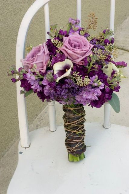 Cozy purple bouquet. Roses, stock, Picasso callas, and seeded eucalyptus.  Tied with ribbon and twine.