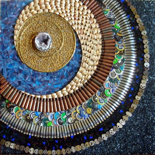 Keys, glass, bottle caps, bullet shells, cork and more goes into this mosaic.  Credit goes to Kathy Thaden.