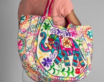 I have made this embroidered bag design from cotton fabric that are embroidered with beautiful floral designs. Inner lining is cotton. I have top stitched along the edge for lasting durability. 100% Cotton. Large size with deep design to hold all your things. Comfortable straps. Perfect everyday bag for all your things. With Zipper  Size: Width 23 inches at its widest x Depth 17 inches. Strap length 10 inches.