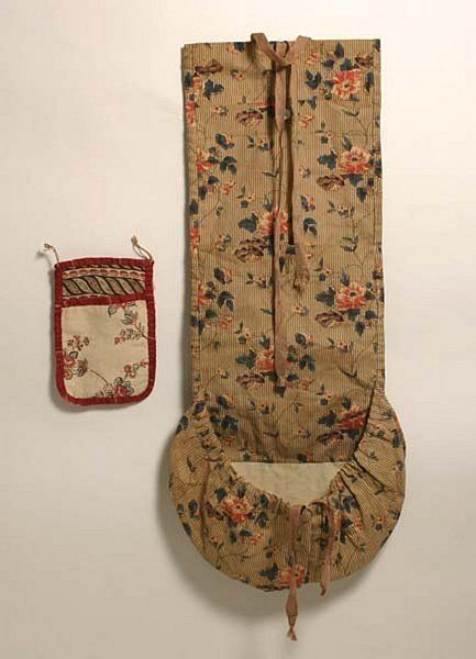 """Two exceptionally fine American needle cases. Small one is linen with silk binding, circa 1800, two tabs for hanging - 5-1/4"""" long by 3-9/16"""" wide. Other rollup dates to about 1820, cotton, measures an unusually large 19"""" long by 6-3/4"""" wide."""
