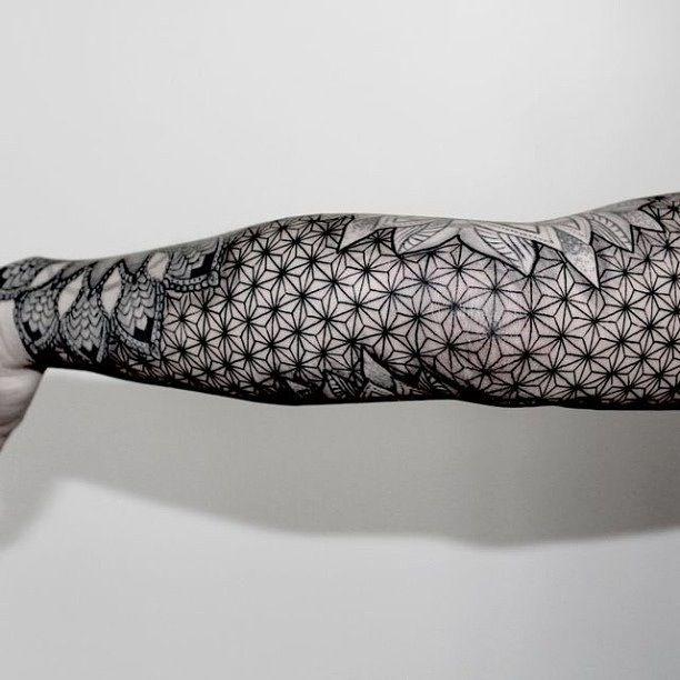 Other side of black and grey linework geometric mandala arm sleeve tattoo