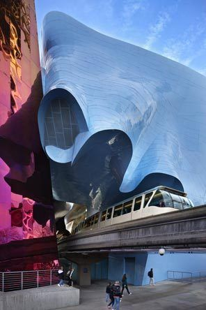 Seattle's Experience Music Project (EMP) feels like moving sculpture as the monorail passes through it.