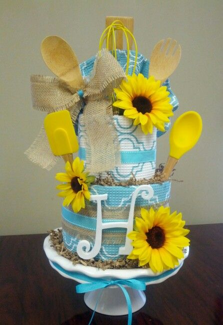 Kitchen towel cake, wedding shower gift, check out my Facebook page Simply Showers.  http://m.me/adorablegifts
