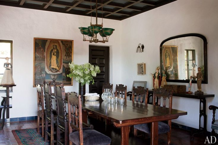 #Sheryl Crow furnished her 1926 Spanish Colonial hacienda in the Hollywood Hills with many items she collected while on tour. The antique dining table was once used in a linen factory, and the light fixture is from the '30s.