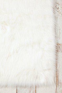 also love this faux sheep skin rug