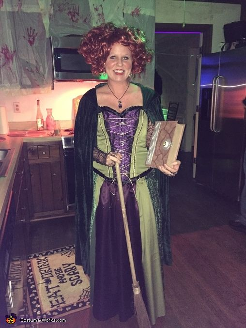 Erin: Winifred Sanderson from Hocus Pocus. Handmade with different fabrics sewen together, added fabrics to a corset and trim.