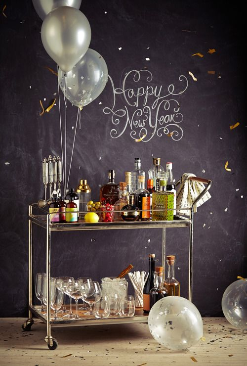 A well stocked New Year's Eve bar cart.