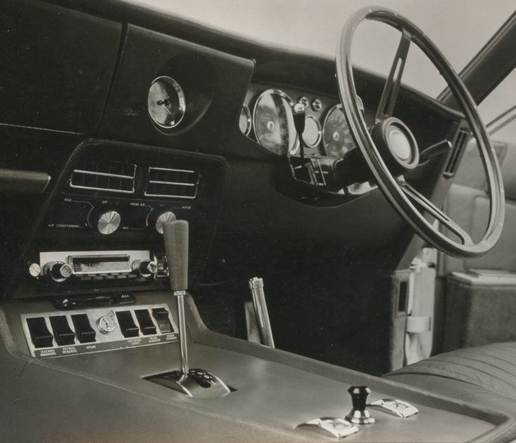 1967 - 1972 Aston Martin DBS. 1193 built. Straight six, DOHC, 3995 cc, 280 bhp @ 4500 rpm. 0-60: 7.1 secs.  V-8: 5430 cc, 320 bhp @ 5000 rpm, 240 lbs-ft @ 5000 rpm. 0-60: 6 secs.