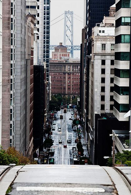 at the top of california street in san francisco | bay bridge in the background | photographer unknown