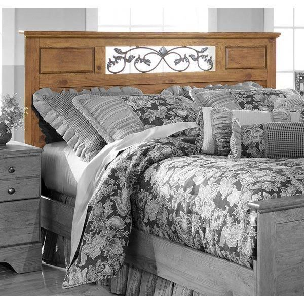 the antique brasstoned scrolling vine insert in the headboard creates a warm look reminiscent bedroom american