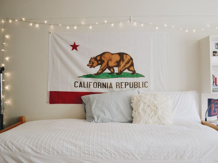 #roomspiration | cute & easy ways to decorate your room or dorm | California flag, fairy lights, ruffled throw pillow, & pure white bedding
