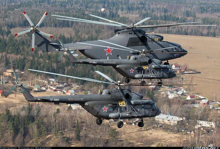 Mil Mi-26 Halo flying alongside two Mil Mi-8 Hip's. The Halo can carry up to an astonishing 90 troops into combat.