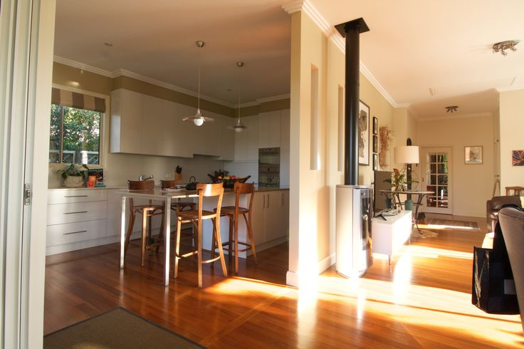 Family area divided from the kitchen with a wall to create a  more intimate space.