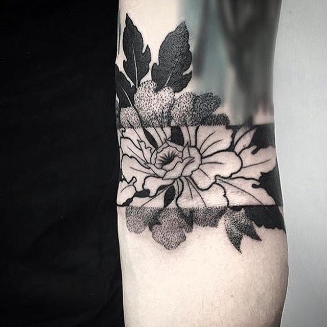 gorgeous geometric blackwork floral mid arm tattoo by @ninasmithtattoo, pin: morganxwinter