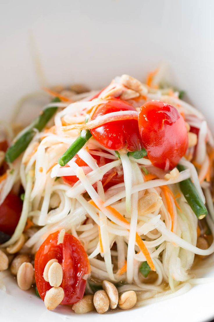 Vegan green papaya salad is a Thai starter recipe known as Som Tum Kap. Ingredients are raw, shredded and muddled together to release fantastic flavours.