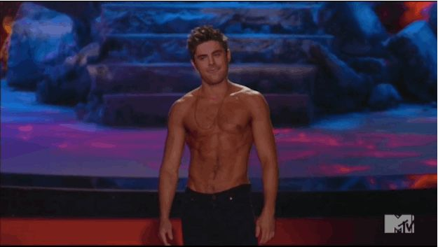 Then he gave another salute because he knew that he just made America proud. | The Only Thing You Need To See From The MTV Movie Awards Is Zac Efron's Shirt Getting Ripped Off